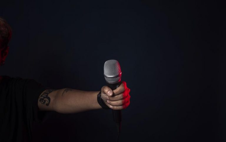 Imagine the moment | Singer on stage holding the mic