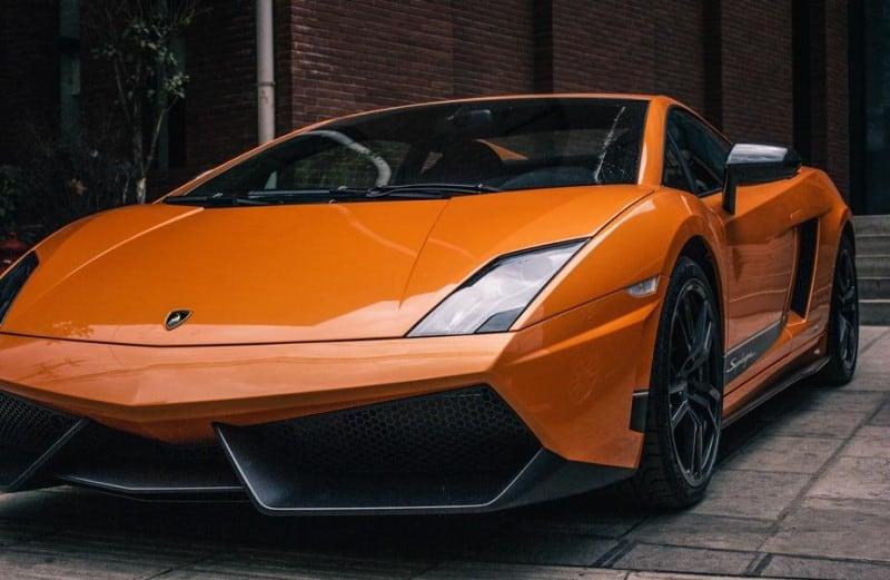 Orange Lamborghini - celebritie repossessed luxury car