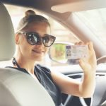 Licence renewal - Lady showing driver licence